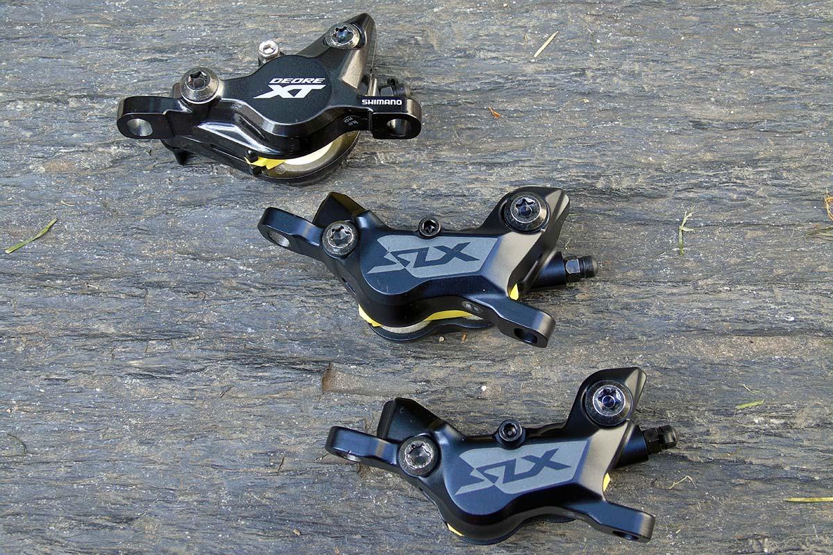 Pinzas de freno Shimano Deore XT y SLX de dos pistones